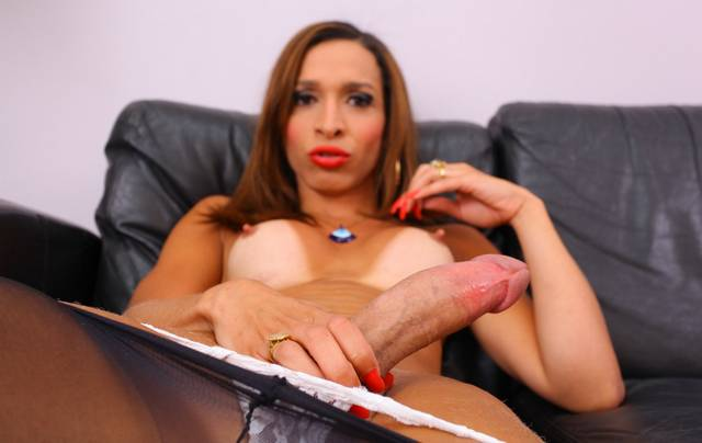 Shemale showing her huge cock